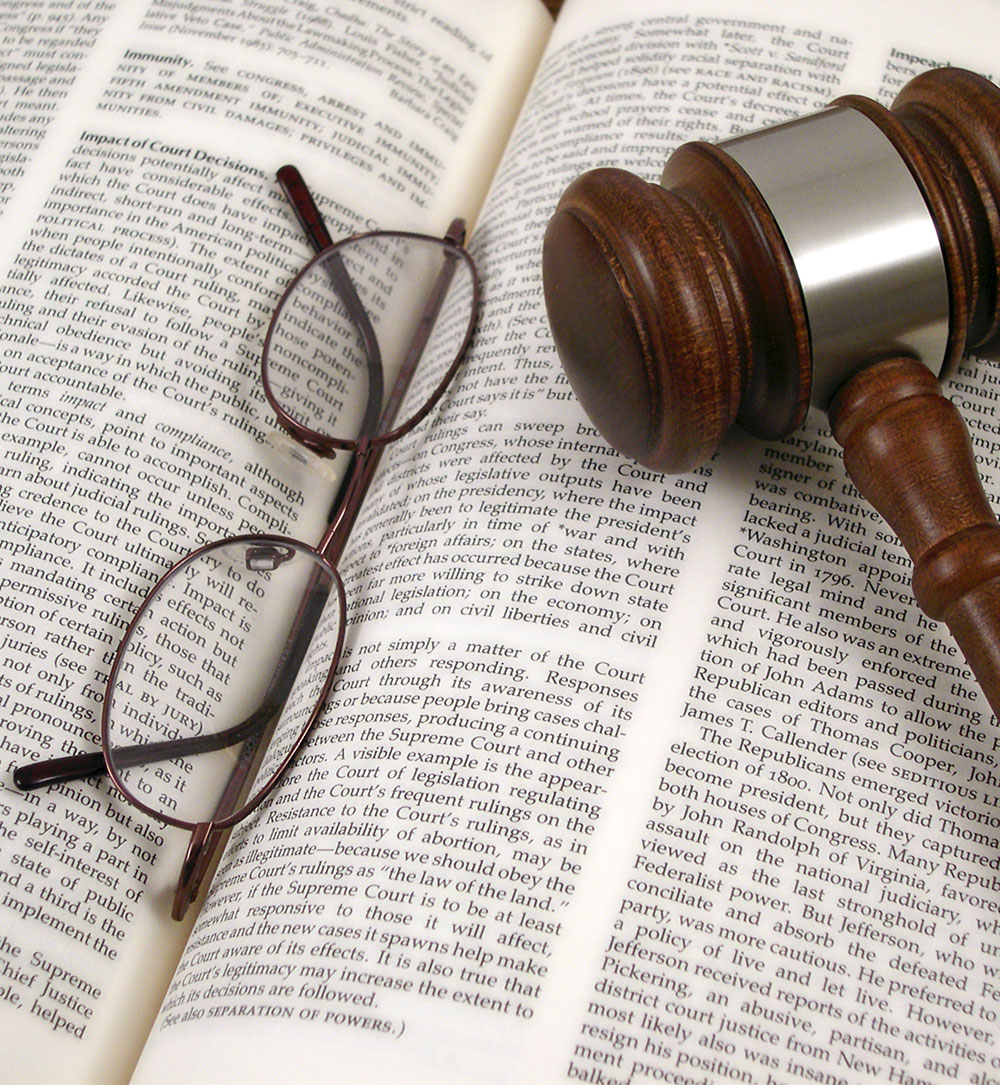 Glasses and Gavel on Open Book